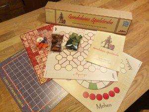 Spielmaterial des Brettspiels Gandubans Spieletruhe von GeMinis Games